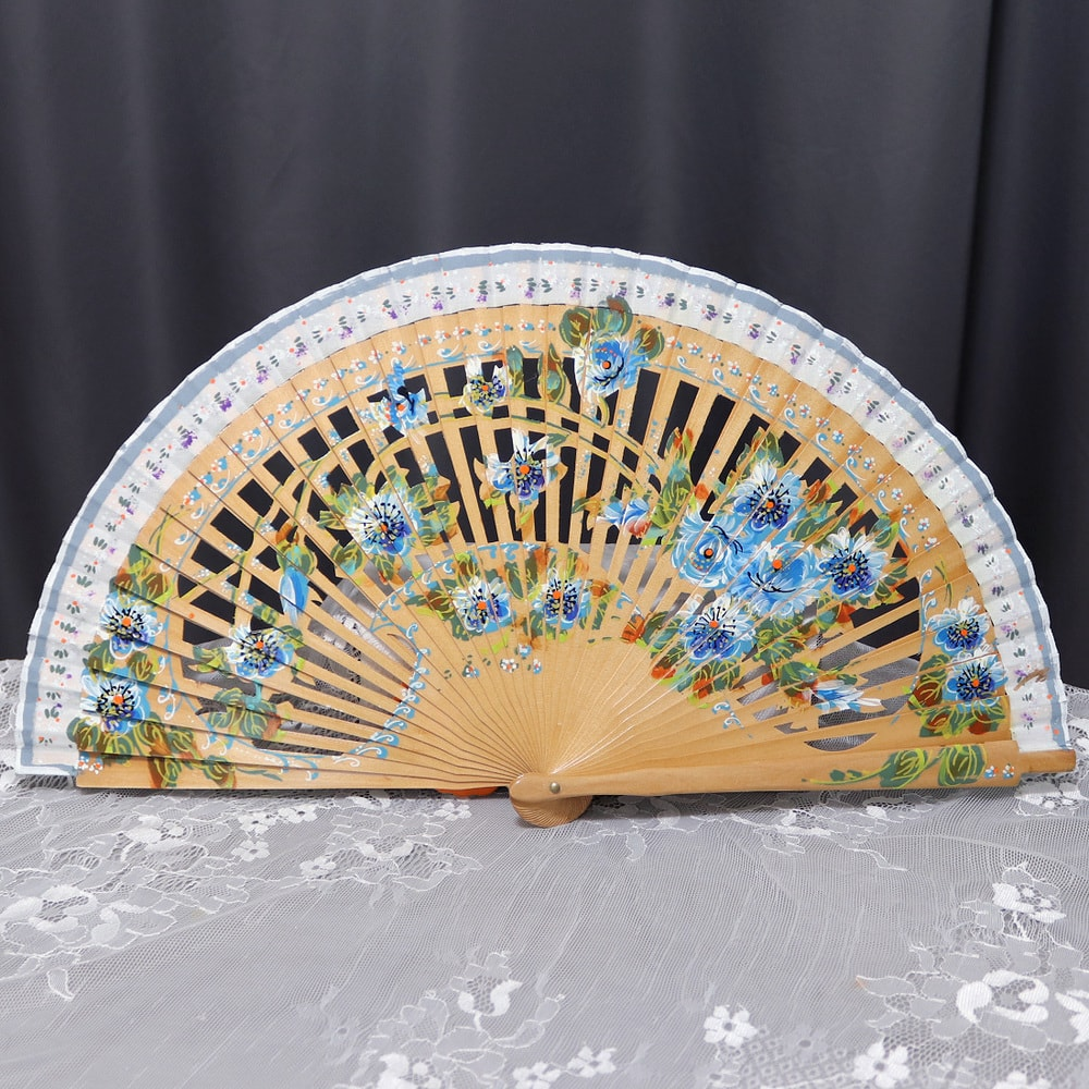 Fan with painted blue flowers